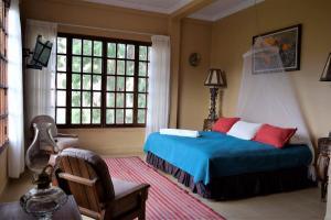 Cama o camas de una habitación en Parador Viña de Pereira