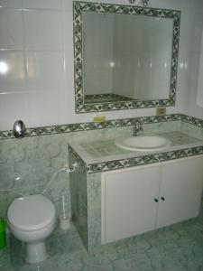 Um banheiro em Guest House Giulio Cesare