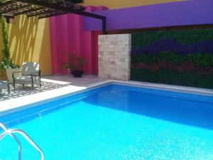 The swimming pool at or near Hotel Plaza Colonial