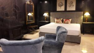 A bed or beds in a room at Hotel Boutique Pinar