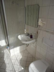 Ванная комната в City Hotel Magdeburg
