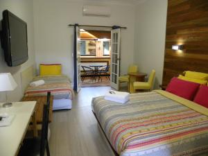 A bed or beds in a room at Ettalong Beach Tourist Resort
