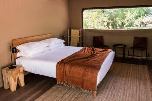 A bed or beds in a room at Cooinda Lodge Kakadu