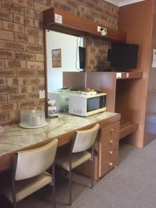 A television and/or entertainment center at Nanango Fitzroy Motel