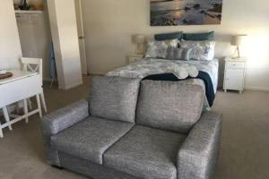 A bed or beds in a room at Broughton Views