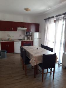 A kitchen or kitchenette at Apartments Petrovic