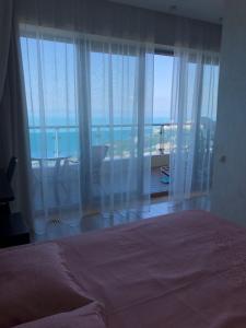 Кровать или кровати в номере Apartament Ideal House