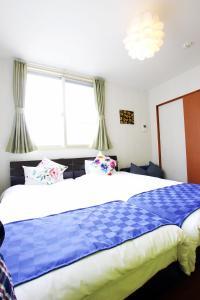 ちゅら民泊 石垣島にあるベッド