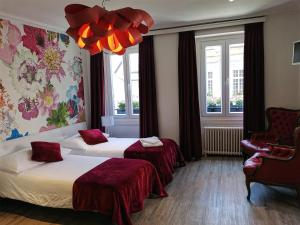 A bed or beds in a room at Hotel du Raisin
