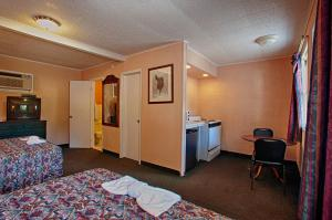 A television and/or entertainment center at Economy Motel Inn and Suites Somers Point