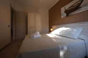 A bed or beds in a room at Club Esse Sporting
