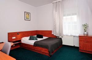 Łóżko lub łóżka w pokoju w obiekcie Hotel Preemier