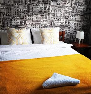 Łóżko lub łóżka w pokoju w obiekcie Pensjonat Poranna Rosa