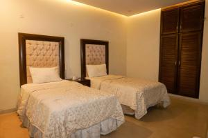 A bed or beds in a room at City View Hotel & Restaurant