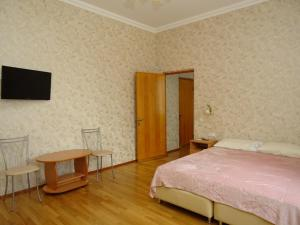 Кровать или кровати в номере Гостевой Дом Анжелика