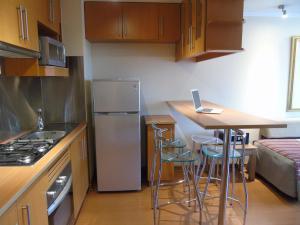 Una cocina o zona de cocina en RQ Providencia