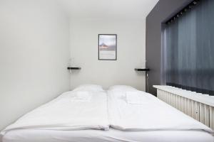 A bed or beds in a room at Captain Reykjavik Guesthouse Bergstaðastræti