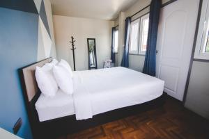 A bed or beds in a room at The August Hostel