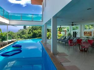 The swimming pool at or near Kamala Heights Villa