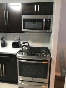 A kitchen or kitchenette at Spacious 2 BR. East Williamburg Apt