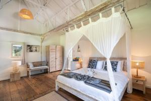 A bed or beds in a room at Gili Eco Villas