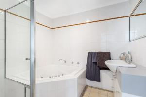 A bathroom at Sandcastles, 1/8 Ala Moana Way