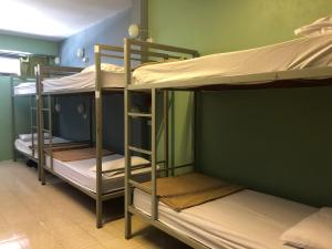 A bunk bed or bunk beds in a room at Baan Tai Backpackers