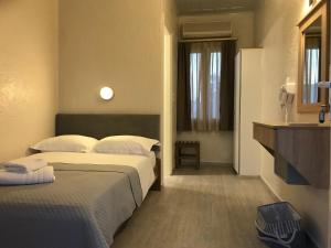 Ένα ή περισσότερα κρεβάτια σε δωμάτιο στο Sailor's Nautical Concept