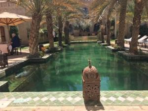 The swimming pool at or near Dar Tozeur