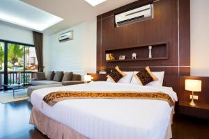 A bed or beds in a room at Rawai Grand House
