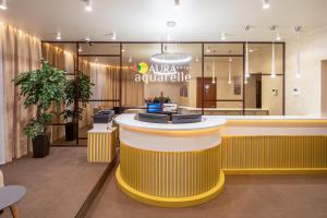Лобби или стойка регистрации в  Aura Aquarelle Hotel