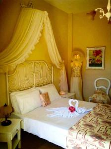 A bed or beds in a room at Saint George Boutique Hotel