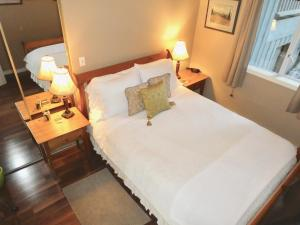 A bed or beds in a room at Belle Neige Suites: Whistler