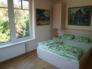 Ein Bett oder Betten in einem Zimmer der Unterkunft Haus Artas