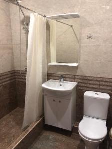 Ванная комната в Приветливый Гостевой Дом