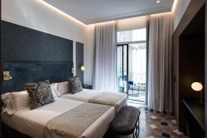 Cama o camas de una habitación en Catalonia Plaza Catalunya
