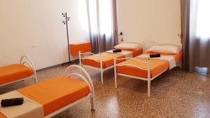 A bed or beds in a room at Casa Fiori