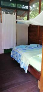 A bed or beds in a room at Passiflora Camp
