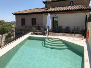 The swimming pool at or near Hotel Los Cigarrales