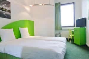 Ein Bett oder Betten in einem Zimmer der Unterkunft Hotel Siru