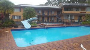 The swimming pool at or near Sanctuary Resort Motor Inn
