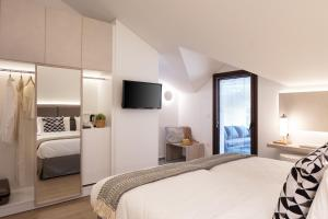 A bed or beds in a room at Hotel Rezi
