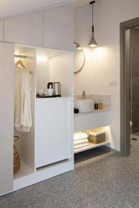 A kitchen or kitchenette at Hotel Rezi