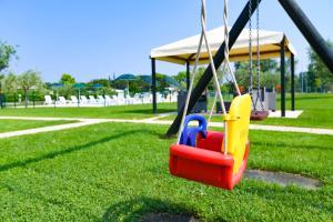 Area giochi per bambini di Appartamenti Residence Parco