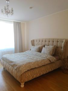 A bed or beds in a room at OLIV apartments on Vilnius avenue