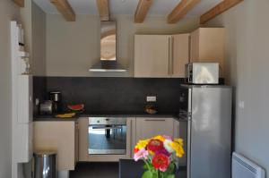 Kuhinja ili čajna kuhinja u objektu Le Chalet La Cigogne et Le Chamois