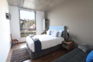 A bed or beds in a room at Bridge It - Suites & Views