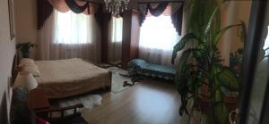 """Кровать или кровати в номере гостевой дом """"Гартензия"""""""