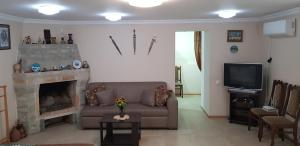 A seating area at Eco-Apartment Buachidze