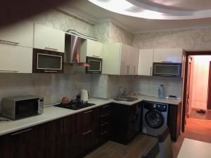 A cozinha ou cozinha compacta de Apartment on 28 May Street